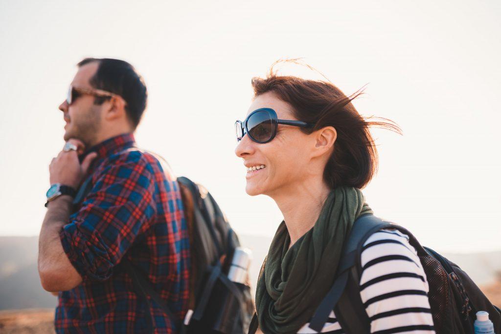 Man and woman outside wearing sunglasses
