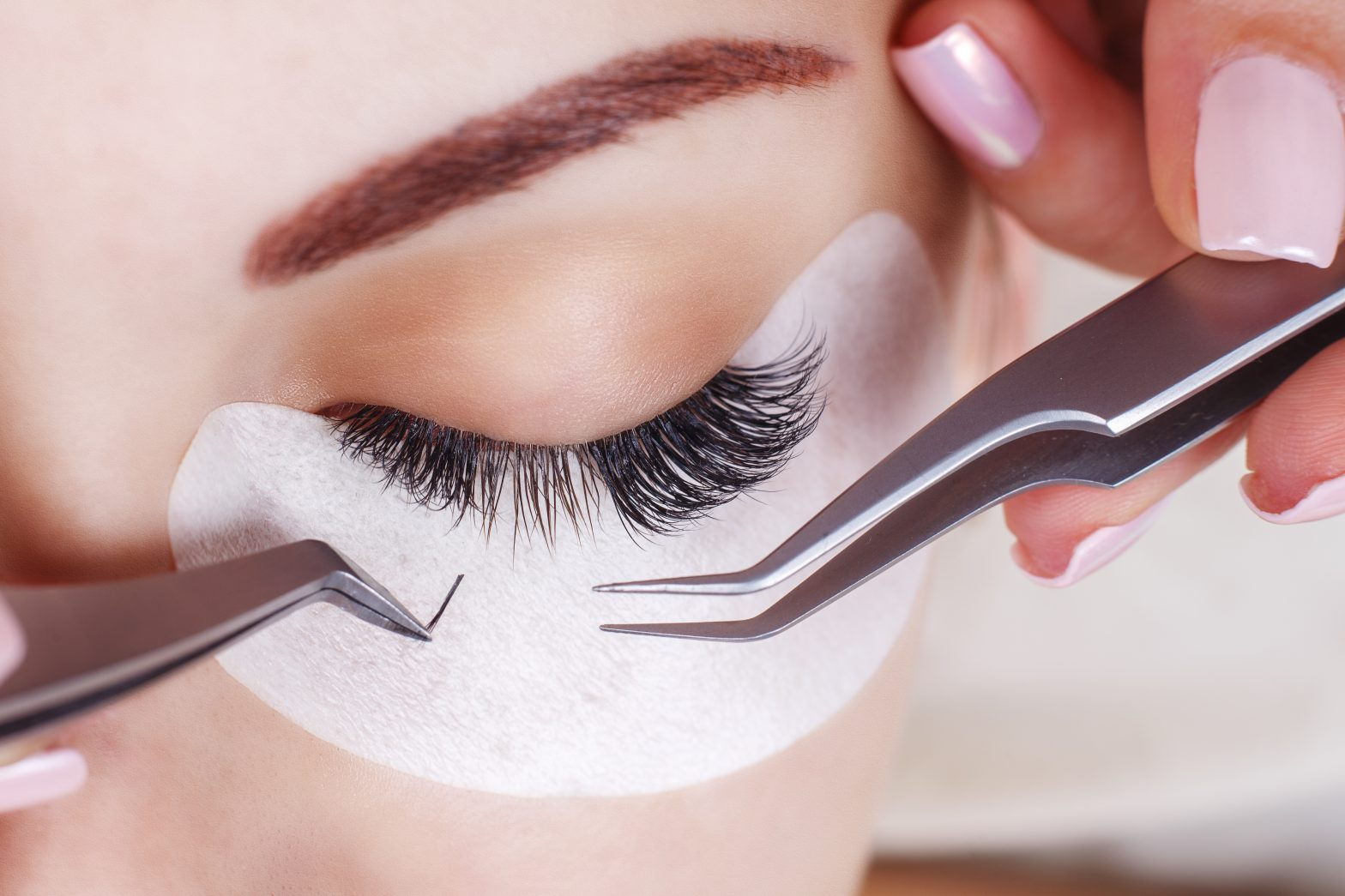 Woman getting eye lash extensions